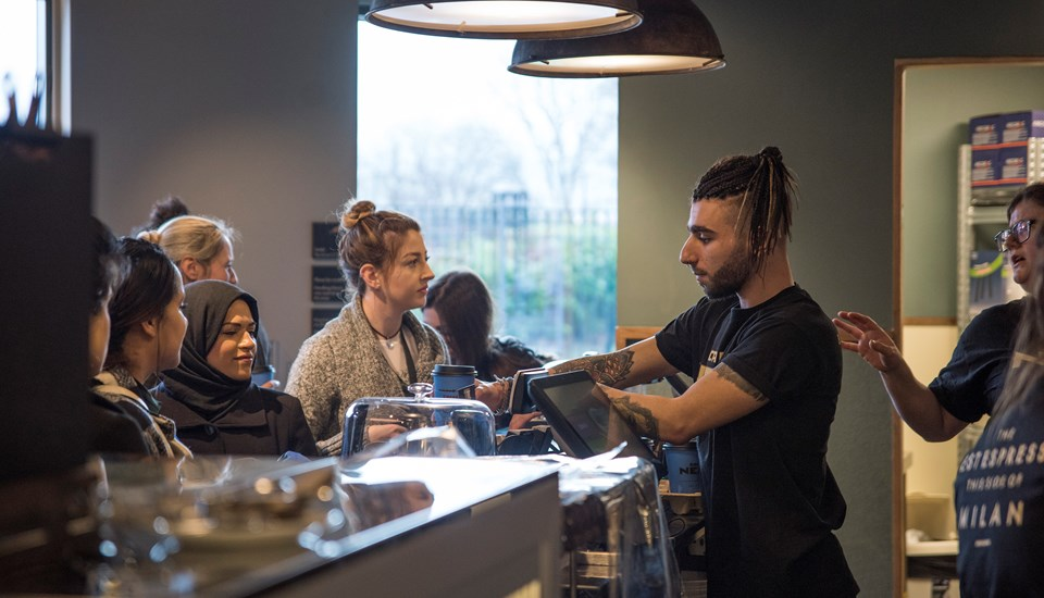 Emirates Old Trafford Caffe Nero staff serve the first customers.jpg